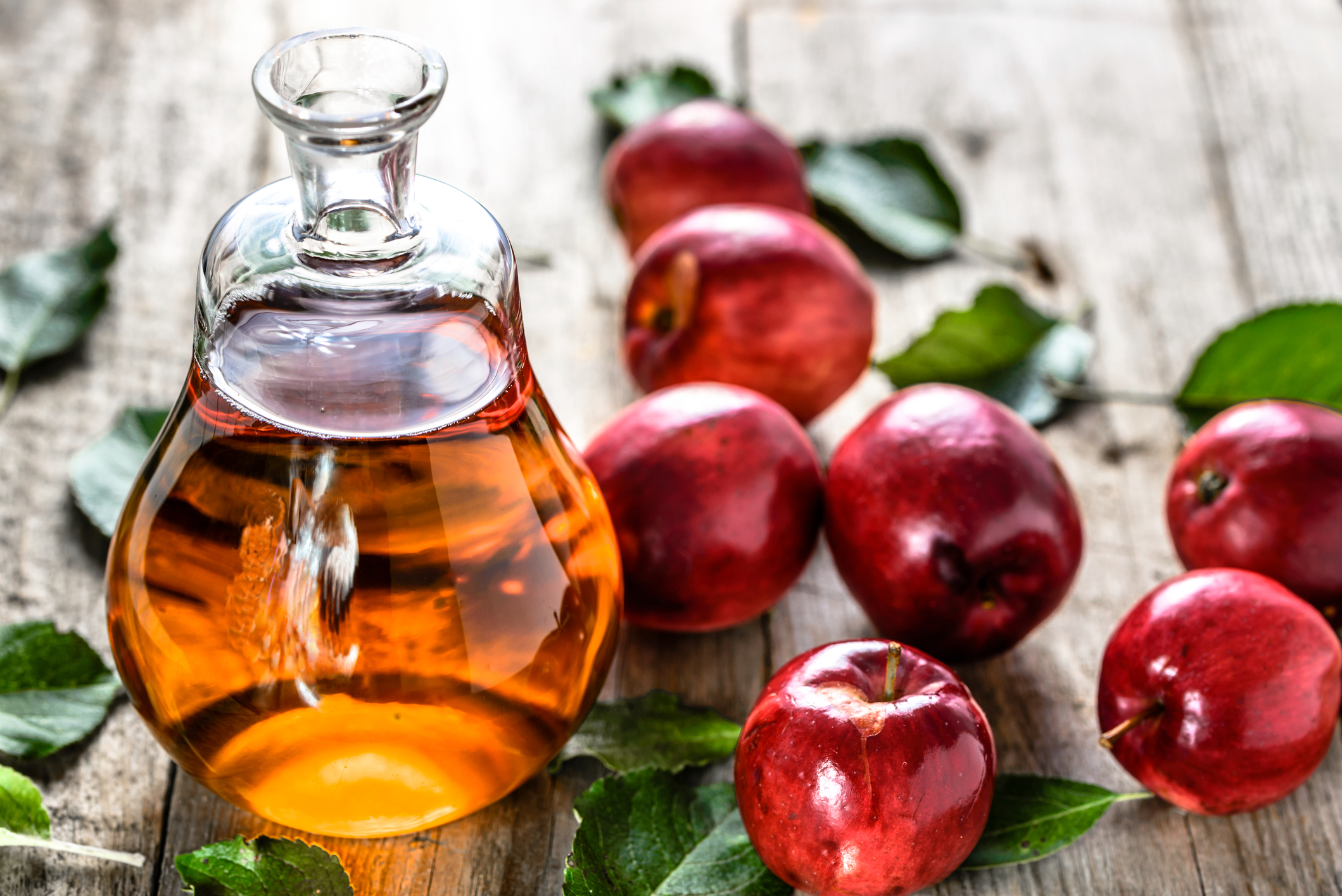Apple cider vinegar or bottle of alcohol drink from fresh apples, organic food, healthy diet concept