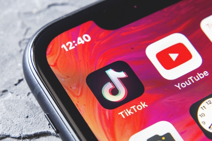 TikTok and YouTube apps on screen iphone xr, close up